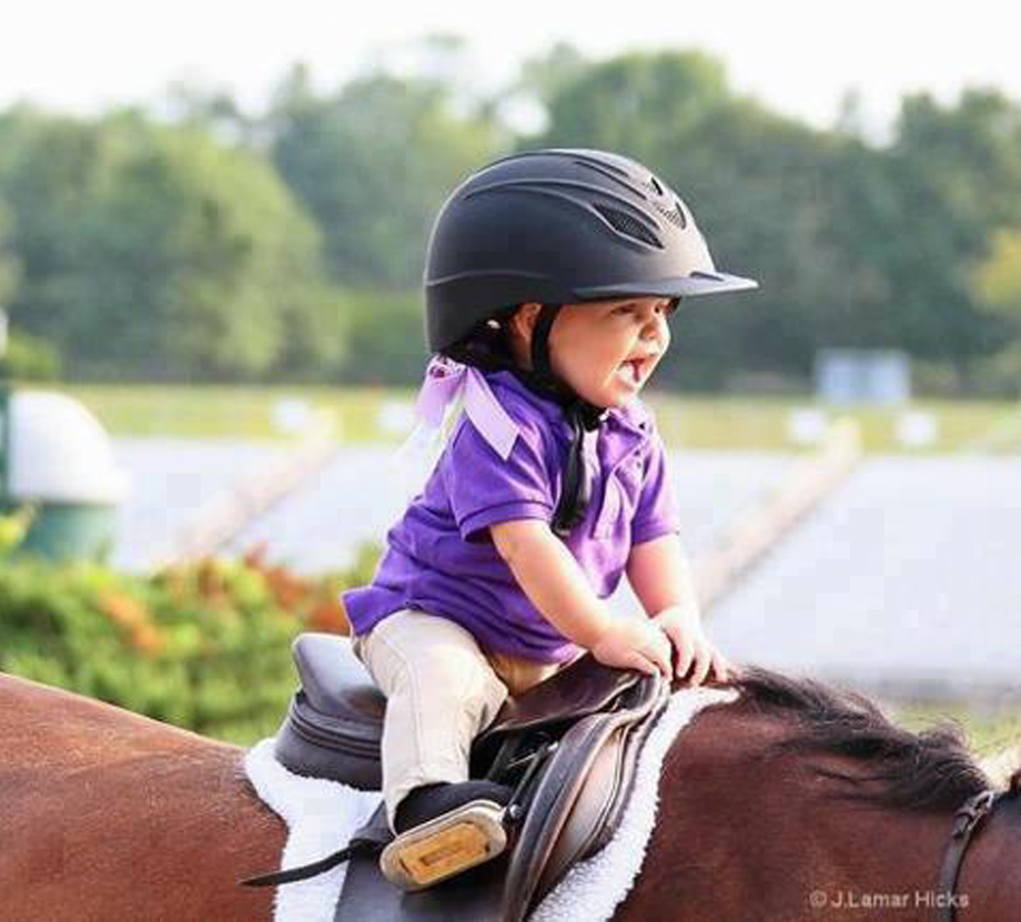 toddler on pony